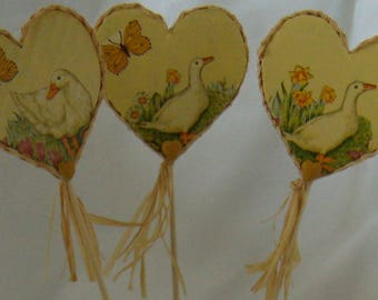 decorative yellow 3 picks in the shape of hearts with geese