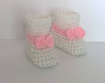 White baby booties and light pink wool knitted hand - 0/3 months baby