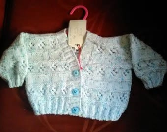 Hand knitted cardigan to fit a child aged 6-12 months old