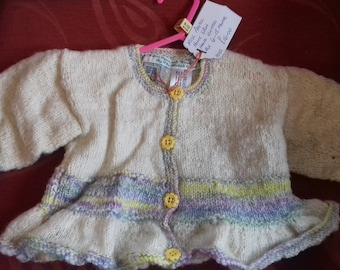 Hand knitted cardigan,  knitted with home spun wool to fit a baby girl aged 6-12 months old
