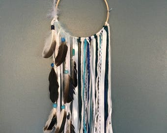 Dream catcher in white and blue tones