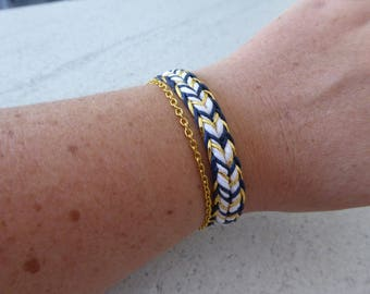 Blue and white chain and gold cord bracelet