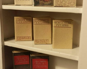D.H Lawrence miniature vintage collection , 1.12 scale with aged blank turnable pages and bookmark.