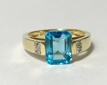 14k yellow gold diamond and Swiss blue lady ring