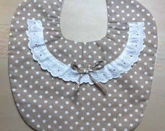 fabric bib with polka dots and eyelet