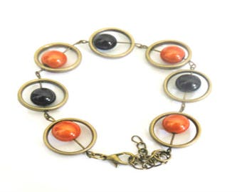 bronze bracelet with orange and black beads