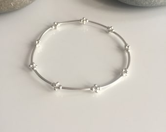 Delicate sterling silver beaded stretch bracelet. Fine sterling silver bracelet. Silver thin tube bracelet. Delicate silver bracelet