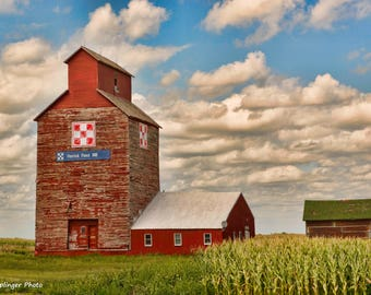"""Original Artist Print -- """"Herrick Feed Mill in South Dakota"""" by Donna Caplinger -- Red Mill Building with Worn-Out Paint and Clouds Behind"""