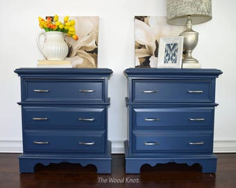 SOLD - Two Bassett dark blue nightstands with new silver handles.