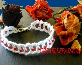 Bracelet with red acrylic beads, length 19cm + - 1 crochet lace