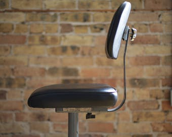 black vinyl ergonomic drafting stool by ajusto