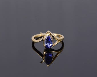 18k 1.00 Ct Iolite Pear Cut Prong Wavy Bypass Ring Gold