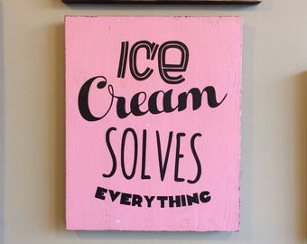 Wooden sign with quote about Ice Cream.