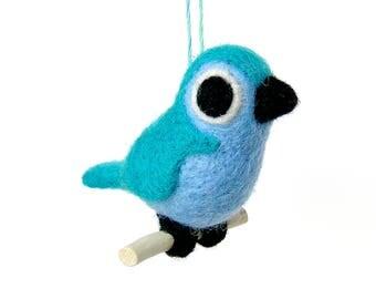 Oiseau en laine feutrée. Bleu turquoise