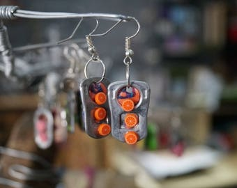 Orange earring capsule