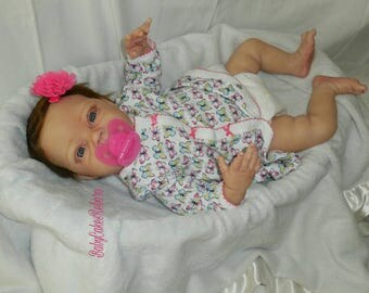 Reborn baby girl collectors doll Natalie sculpted by Denise Pratt.