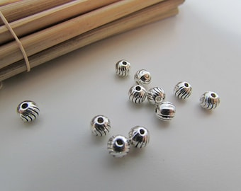 20 round beads surrounded by 4mm silver metal, gilded - 0.7 mm hole