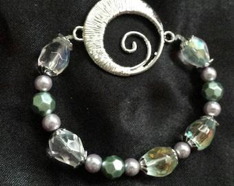 Crystal and glass beaded swirl bracelet