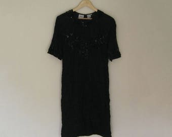 Black short sleeve party dress with beaded overlay - size 12 - J.R.T.