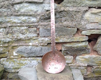 Copper ladle, slotted spoon.