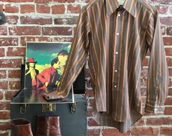 Sold in store. Do not buy. Vintage Seventies 1970s Men's Striped Button Down Shirt.