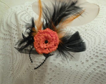 Orange/black brooch with feathers, crocheted with recycled plastic bags, handmade
