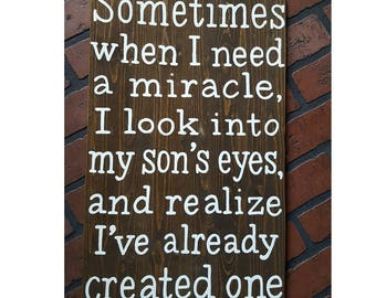 Sometimes when I need a miracle, I look into my son's eyes, and realize I've already created one wood sign