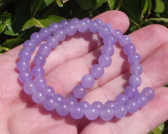 4 ROUND 6 MM PURPLE ALEXANDRITE BEADS.