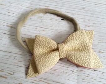 Ivory Faux Leather Bow on White or Nude Nylon Elastic Headband | Vegan leather baby headband | Baby Shower Gift | Infant Headband | Baby Gir