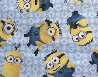 "Minions toss on Gray VIP, 43-44"" wide, 100% cotton, by the half yard"