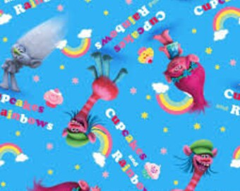 "Trolls cupcakes and rainbows on blue fabric, By the Half Yard, 44"" wide, 100% cotton"