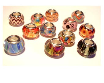 Set of 12 European beads in assorted colors and patterns