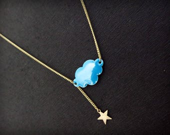 Blue enamel and brass star cloud necklace