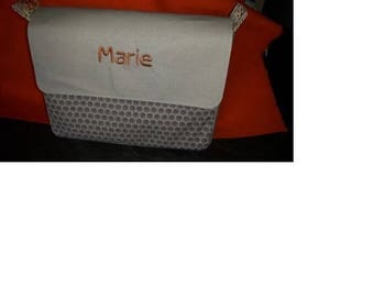 clutch bag with custom flaps that can be put into a