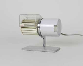Electric desk fan designed by Reinhold Weiss for Braun.  Germany, 1960s.