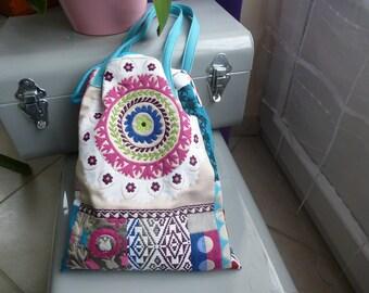 handbag multicolor turquoise cord closure