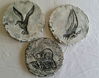3 vintage chalkware / plaster round wall plaques signed art - seagull beaver sailboat garden stones flower beds stoneware drawings decor