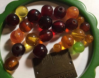 20+ assorted clear bakelite beads