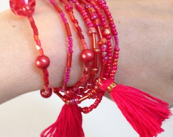Bracelet or necklace of red and pink and orange glass beads - tassels - handmade jewelry - gift for woman - gift for girlfriend - boho style