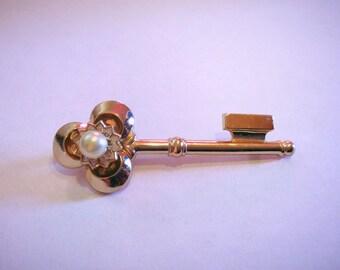 Vintage Coro Pegasus skeleton key brooch, Mid Century gold tone key brooch with faux pearl.