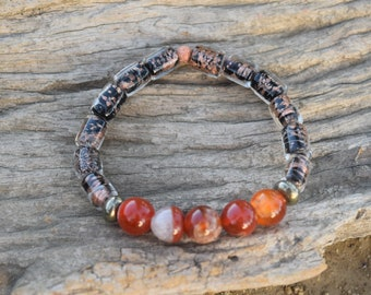 Handmade stretchy bracelet with fire agate, pyrite and black and gold beads