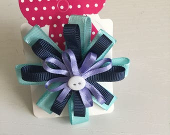 Circular blue hair bow