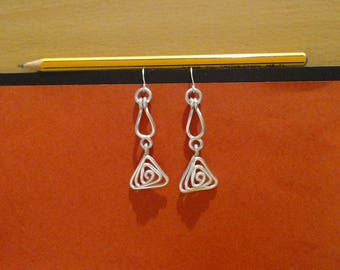 "Style East. Special earrings, elegant, trendy, very light. Warnings: cause a sudden ""whoa!"""
