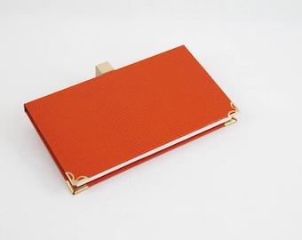 Protects checkbook / checkbook holder in orange skivertex