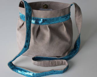 Small purse from Taupe suede and turquoise glitter band