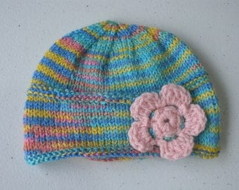 Knitted rainbow beanie with crocheted flower for newborn baby girl