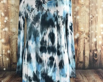 Shades of blue, black, and white bell sleeved tunic
