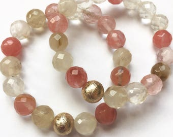 Multi beaded bracelet with gold accent