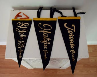 Three Vintage Canadian Scripted Pennants