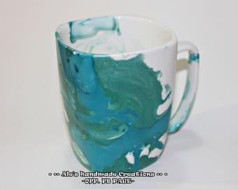 Ceramic mug decorated with enamel